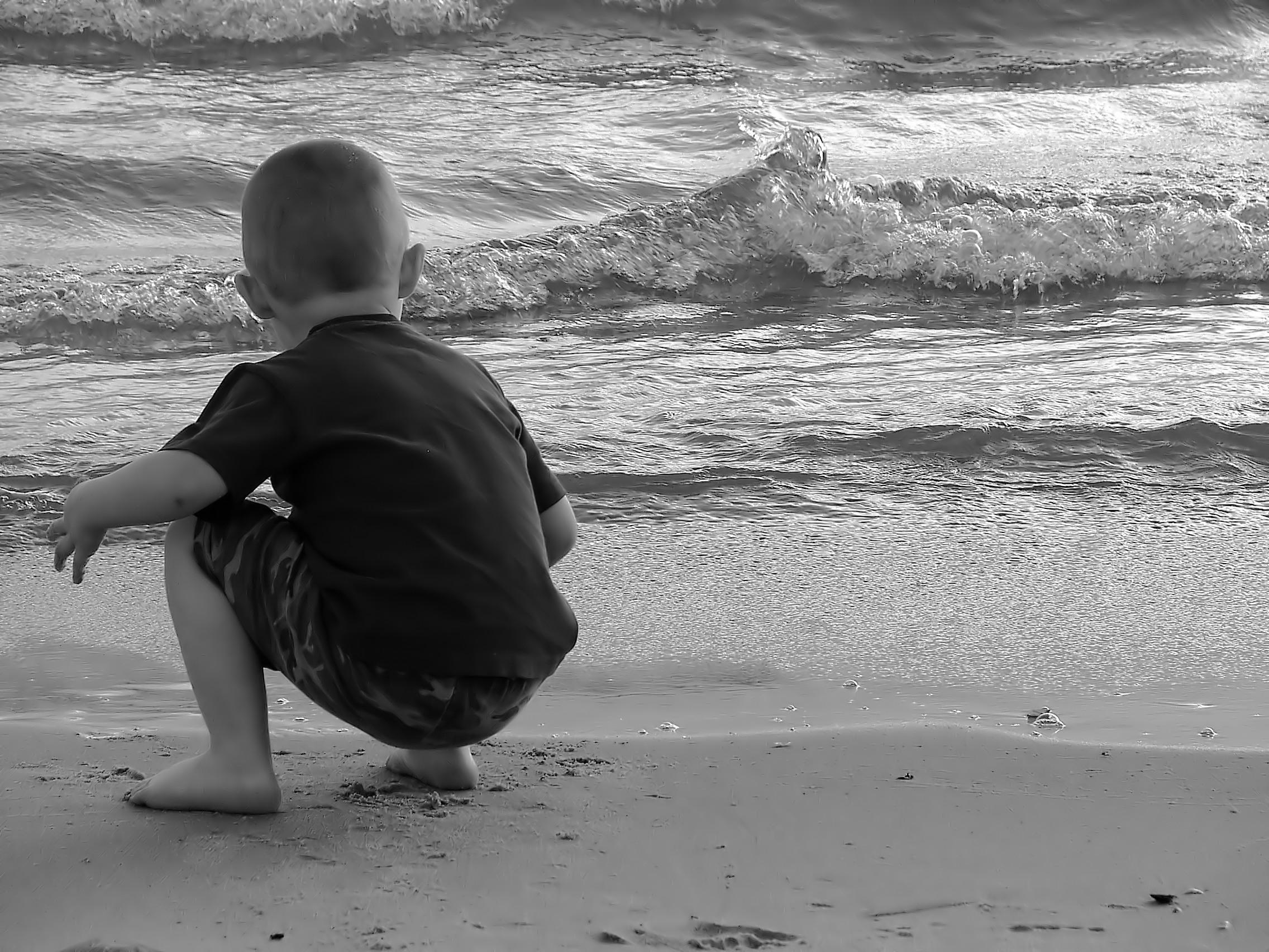 bw little boy on beach