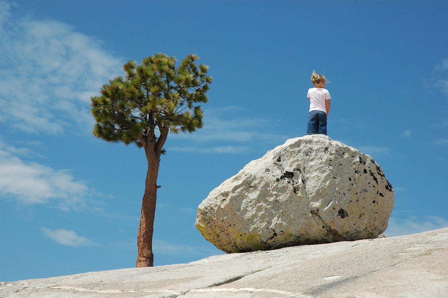 little girl on a rock
